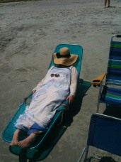 Hiding from the sun and trying not to burn.